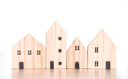 wood house and home village model on isolate white background for family happy home love life and commercial concept Banque d'images