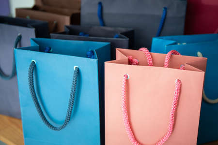 pink and blue color shopping bag or gift on wooden shelf for shopping concept in summer sale of department store and fashion customer outlet Banque d'images