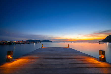 beautiful and paradise sunset view over wood bridge harbor bay for speed boat in island near Pattaya Thailand, relax location for travel in summer during sunset over the sea in Thailand, South East Asia