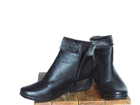 burnished: Black leather shoes white background. Stock Photo