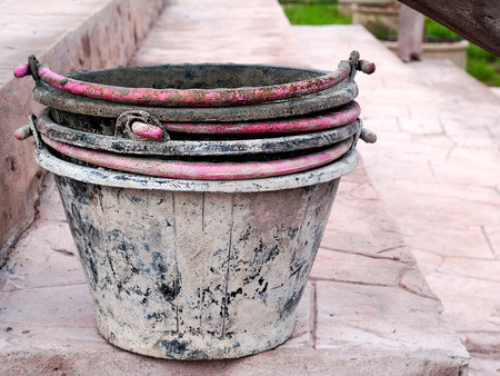 pail: Pail used lime in building construction.