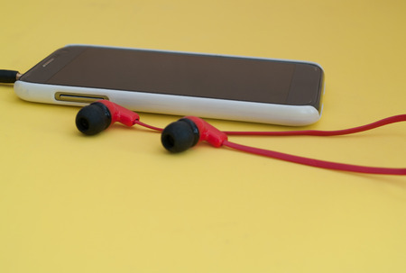 mobile headset: Telephone, mobile use with a headset on the floor yellow.