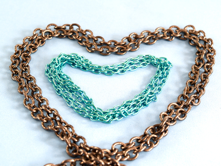 bind: To bind together and form the heart with love. Stock Photo