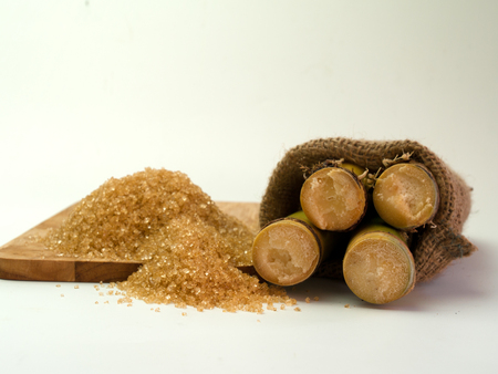 yielding: Sugarcane and sugar , Sugar cane, yielding a brown sugar.