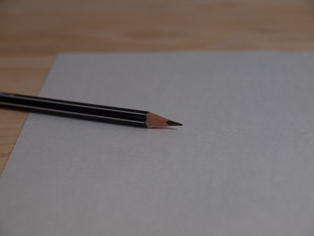 memo pad: paper and pencils ,Placed on a wooden floor.