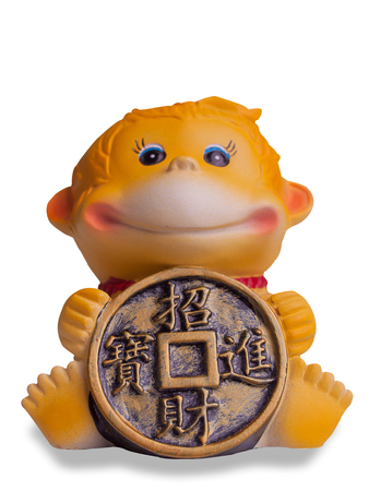 path to wealth: monkey toy , We wish you wealth and success , isolated on white background. (clipping path)