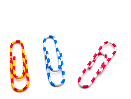 Colorful paper clip on white background. (with free space for text)