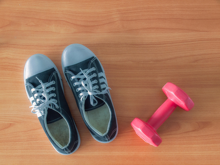 Sports shoe and dumbbell. Healthy Workout Concepts. Stock Photo