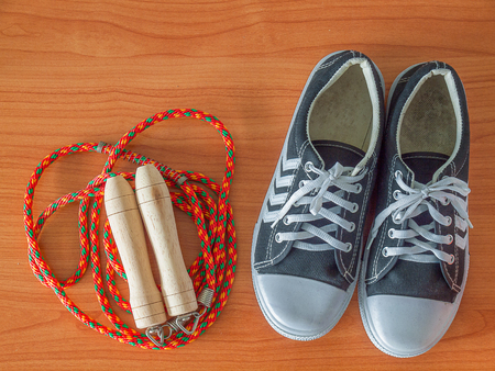 Sports shoe with a Jump rope. Healthy Workout Concepts.