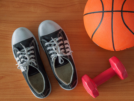 Sports shoe with a basketball and dumbbell. Healthy Workout Concepts. Stock Photo