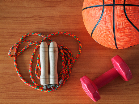Jump rope with a basketball and dumbbell , Sports Equipment. Healthy Workout Concepts. Stock Photo