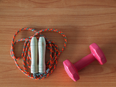 Jump rope and dumbbell , Sports Equipment. Healthy Workout Concepts. (with free space for text)