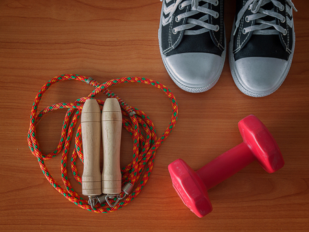 Sports shoe with a Jump rope and dumbbell. Healthy Workout Concepts.