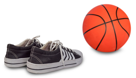 Sports shoes with a basketball in background.(with free space for text) Stock Photo