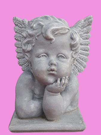 Cupid sculpture isolated on pink background. (clipping path)