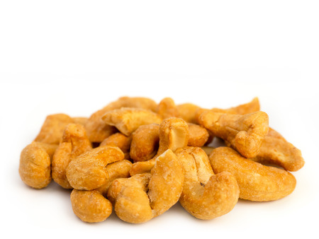 cashew nuts heap isolated on white background.