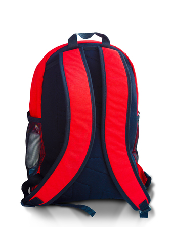 red backpack in black back  isolated on white . Stock Photo