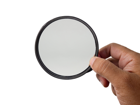 Hand holding magnifying glass isolated on white background. (This has clipping path)