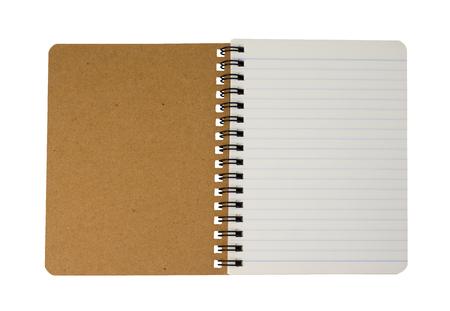 Widok z góry brązowy spiralny notatnik na białym tle. (To ma ścieżkę przycinającą)