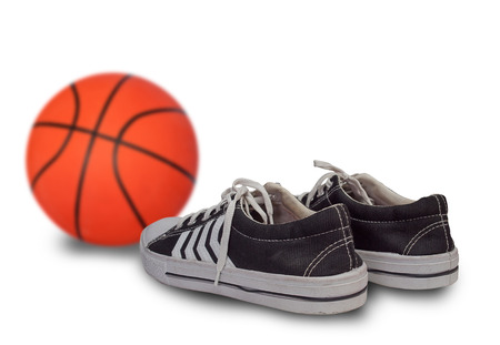 sport shoes and basketball ball. (Sports and health concepts)