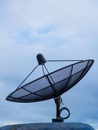 Satellite dishes communication technology network blue sky in the background.(with free space for text)