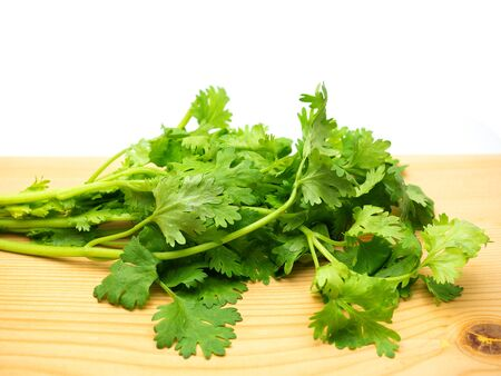 fresh coriander leaves put on a wooden floor. (Good food for health)