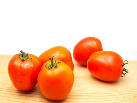 Juicy red tomatoes on a wooden floor. (with free space for text)