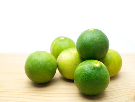 Lime isolated on a wooden floor. (with free space for text) 版權商用圖片