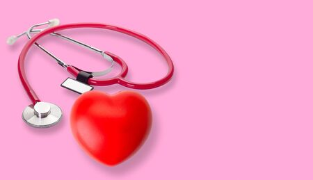 medical stethoscope and red heart , heart check. (concept healthcare)
