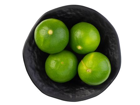 Fresh ripe green limes isolated on white background.