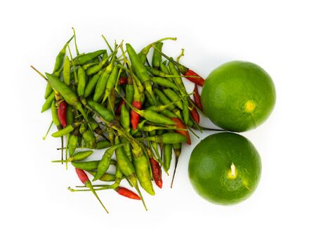 Lime cut and chili isolated on white background. 写真素材