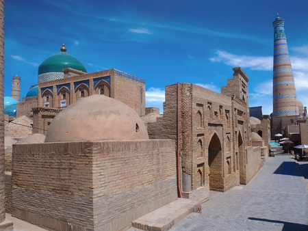Corner view of old city of Khiva. Domes, minarets and Mosques under perfect blue Stock Photo
