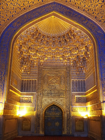 Golden mihrab of Tilla Kari (or Tilya-Kori) with islamic patterns, Madrasa in Registan Square, Samarkand, Uzbekistan