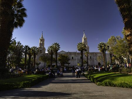 People on the Main Square (Plaza de Armas) with colonial Cathedral in the background. City of Arequipa, Peru Stock Photo