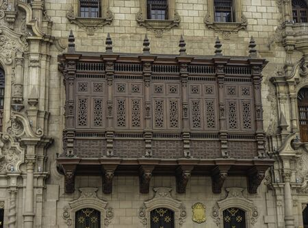 Balcony carved in wood in Archbishop's Palace of Lima, Lima city, Peru 에디토리얼