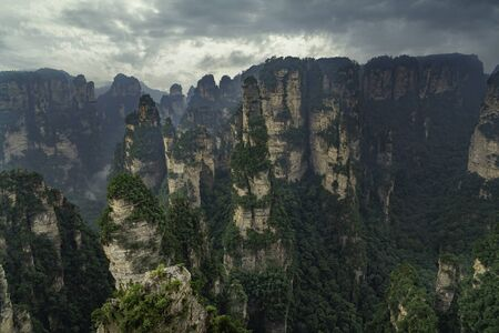 Aerial landscape from above. The first national forest park in China and a world nature heritage. Pillar mountains rising from the canyon. Zhangjiajie Natural Park, Hunan province, China. Stockfoto