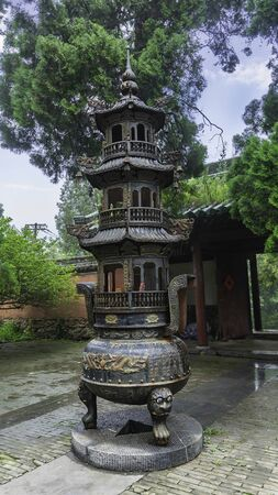 Bronze carved censer where monks make incense offerings. Central courtyard in Shaolin temple, Dengfeng, Henan Province, China.
