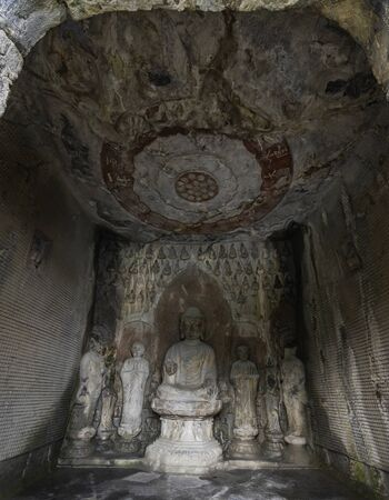 Tang dynasty figures carved in limestone. The Wanfo Cave in Longmen Grottoes, Henan province, China