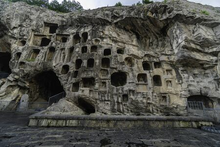 Caves on west hill limestone cliff. Longmen Grottoes Luoyang, Henan province, China