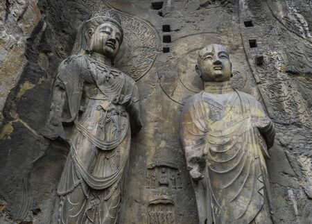 Big statue made in limestone of monks and bodhisattvas. The main cave (Fengxiangsi Cave) of Longmen Grottoes in Luoyang.