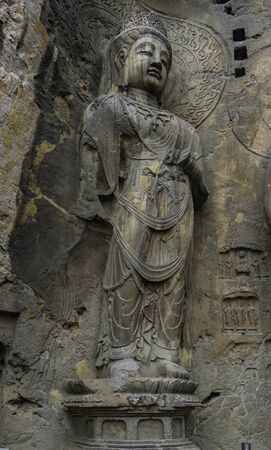 Big statue made in limestone of bodhisattvas. The main cave (Fengxiangsi Cave) of Longmen Grottoes in Luoyang.