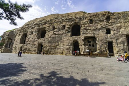 Facade of niches and caves where sculpted inside the mountain. Yungang Grottoes near Datong, Shanxi Province, China
