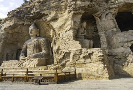 Bid buddha statues carved directly on a mountain hill. Yungang Grottoes in Datong, Shanxi Province, China