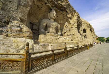 Ancient giant Buddhas statues carved on a mountain. Yungang Grottoes near Datong, Shanxi province, China.
