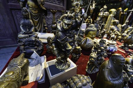 Bronze statue of Hanuman in shop window of a souvenir and antique shop. Pingyao Ancient City, Shanxi province, China Stock Photo