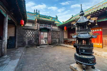 Inner courtyards where monks studied and burned incense on incensory. The God of Wealth Temple (Cheng Huang Temple), Pingyao Ancient City, Shanxi province, China