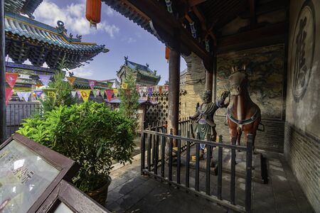 Buildings, pagoas, courtyards and figures of protecting warriors at The God of Wealth Temple (Cheng Huang Temple), Pingyao Ancient City, Shanxi province, China