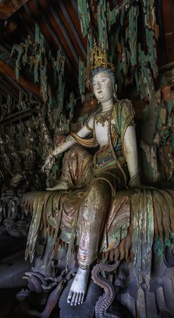 Supreme wood carving of bodhisatta statue. Avalokitesvara sculpture. Finest chinese art at Shuanglin Temple (or Zhongdu Temple), outskirts Pingyao Old City, Shanxi province, China