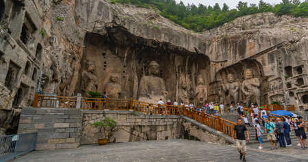 The main cave (Fengxiangsi Cave) of Longmen Grottoes in Luoyang,. A major Buddhist caves of China Redactioneel