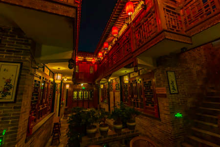 Night view of old chinese house with traditional style. Typical balconies and Chinese lanterns. Pingyao Ancient City, Shanxi province, China